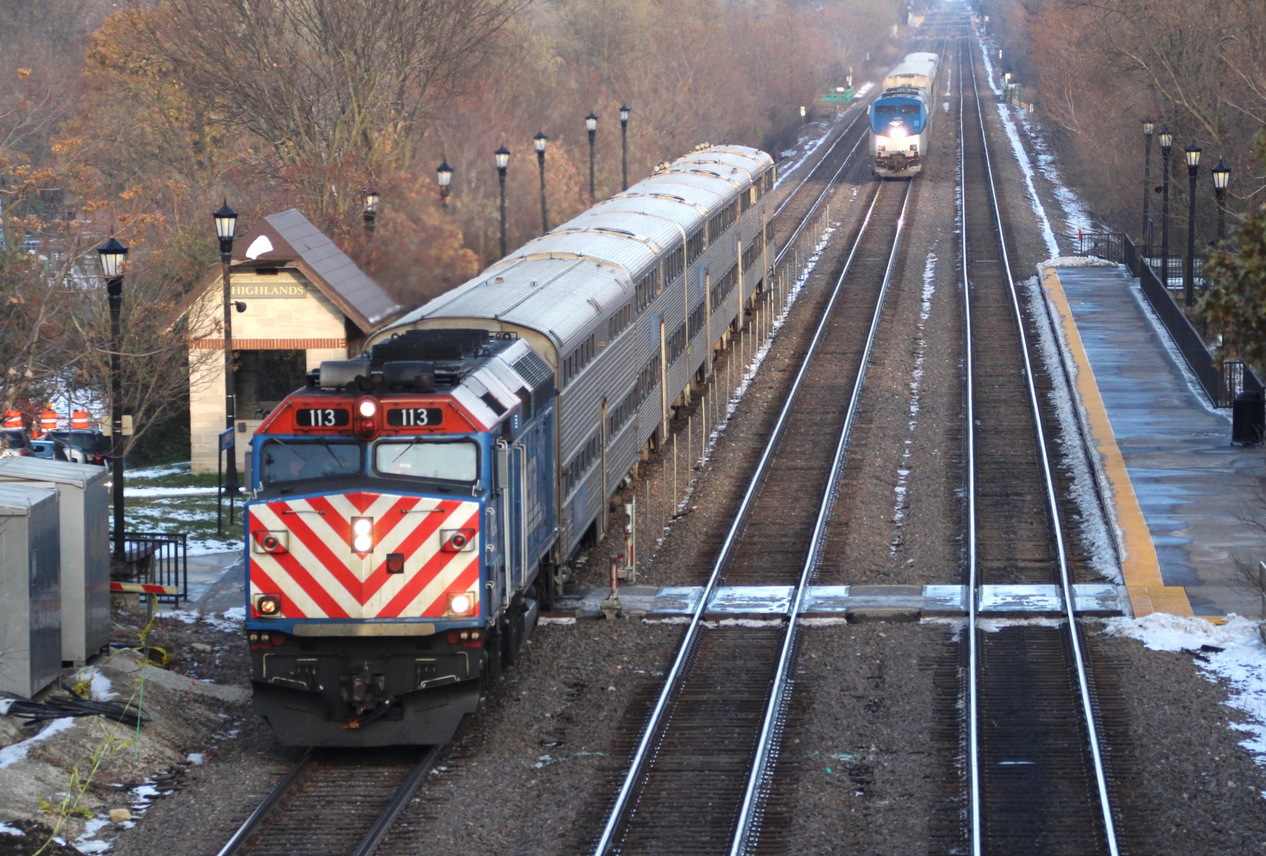 A Metra BNSF train stops at Highlands station in Hinsdale, Ill., on Nov. 15, 2019 as Amtrak's Southwest Chief approaches. Highlands is among the 31 stations to be upgraded by Metra in the next five years.