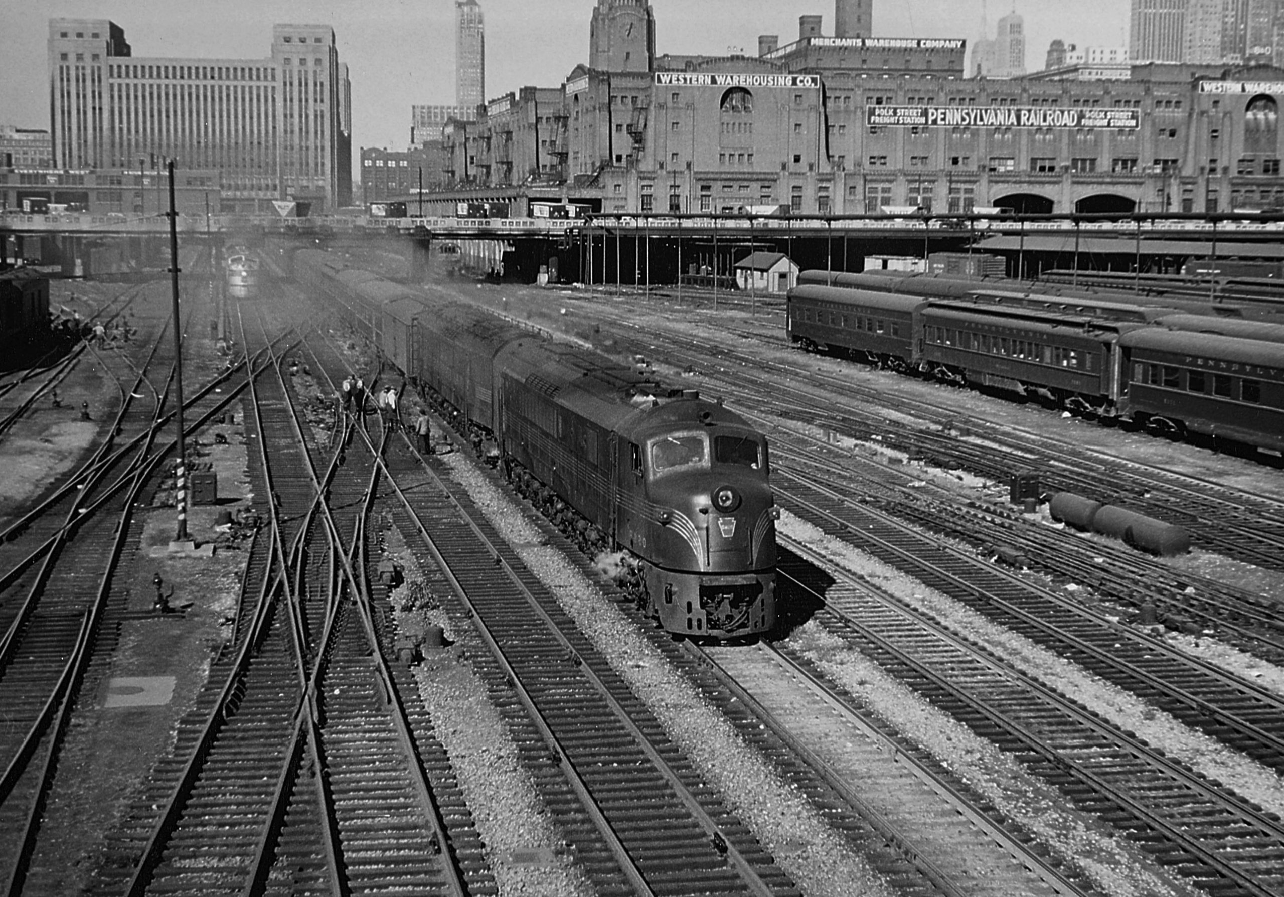 "Two Baldwin ""Centipede"" diesel locomotives depart Chicago Union Station with the Union bound for Cincinnati in October 1950. Part of PRR's big Chicago coach yard is at right."