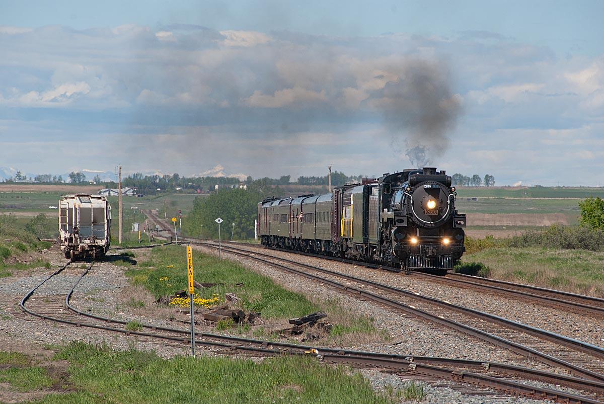 Steam locomotive with short train on prairie
