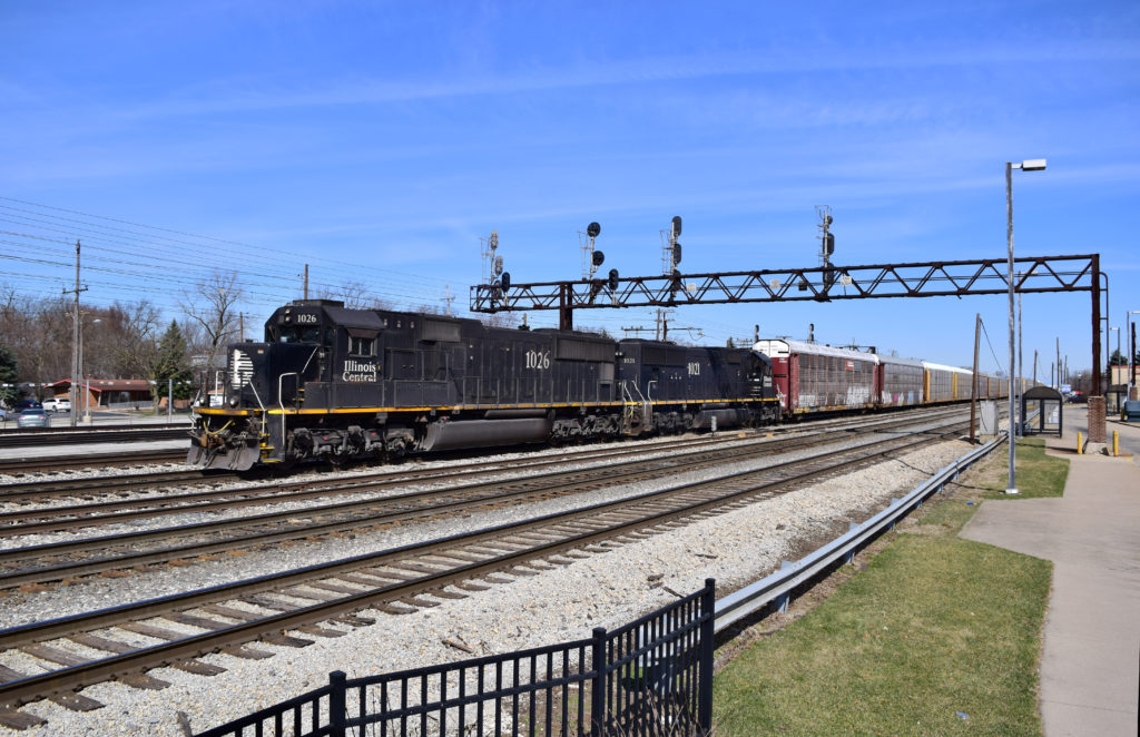 Illinois Central locomotives lead a train at Chicago's Markham Yard.