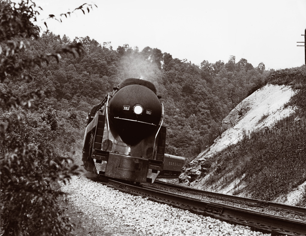 A close up shot of a train turning the corner