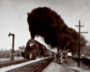 Two guys stand off to the side as a train passes by with big black smoke coming out of its chimney