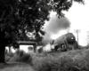 A train passing below a bridge
