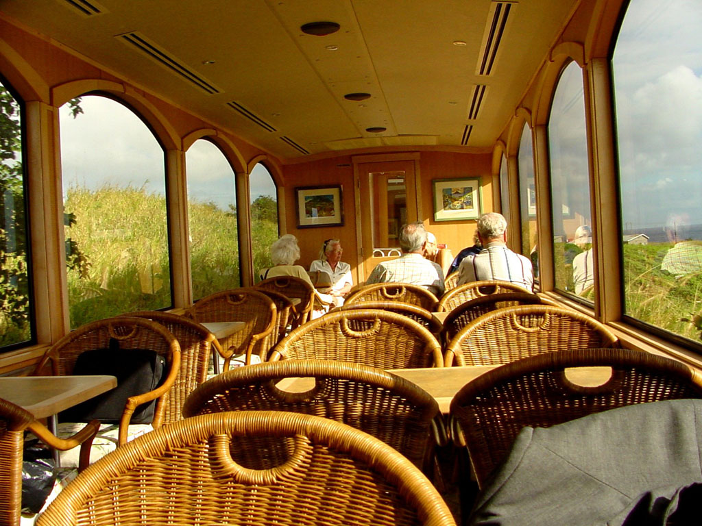 The open-air top deck of St. Kitts Scenic's railcar
