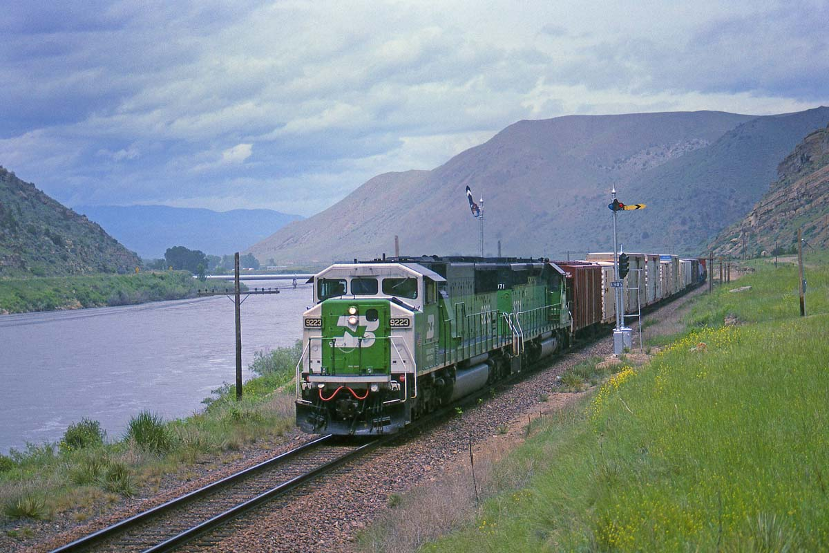 On June 10, 1993, a Burlington Northern SD60M and SD40-2 take an eastbound freight along the Missouri River and into Lombard Canyon just east of Toston, Mont.