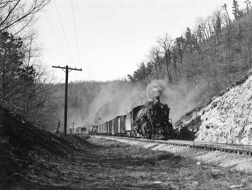 A black and white photo of K-4 2-8-2 Mikado heading down the tracks