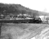 A black and white photo of Clinchfield 4-6-2 No. 154 turning a corner on the tracks