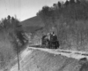 A black and white photo of Clinchfield coming out of a tunnel on a raised track