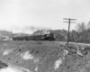 A black and white photo of the Clinchfield Railroad 4-6-2 coming down the tracks on a raised track