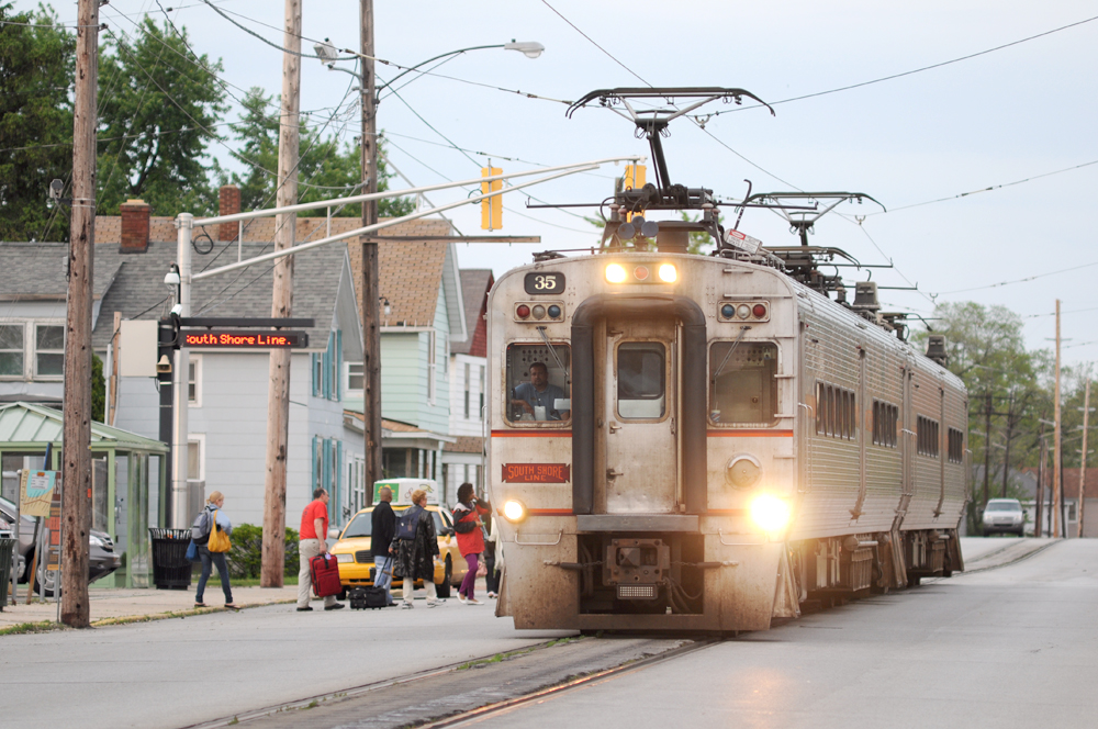 A South Shore Line train trundles through city streets in Michigan City, Ind.