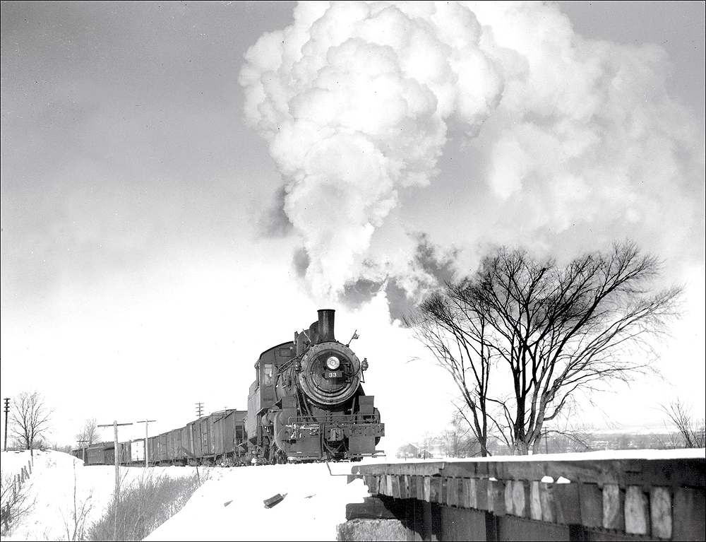 Steam locomotive with freight train in snow