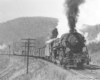 Steam locomotive with freight train on curve