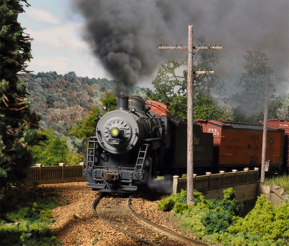 Steam locomotive rounding a bend