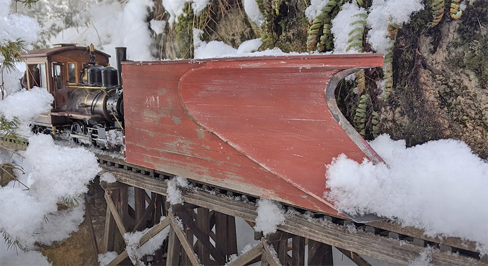 plowing snow on a garden railway