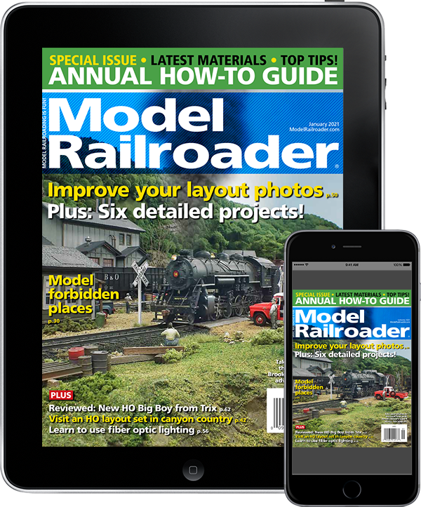 A tablet and mobile phone featuring a cover of Model Railroader