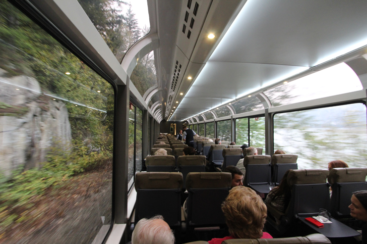 Rocky Mountaineer patrons in Silver Leaf cars enjoy the scenery and service on a trip from Vancouver, British Columbia, in October 2018