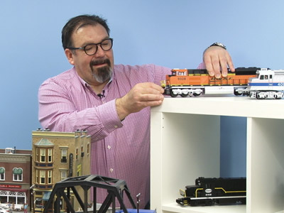Man Setting up Orange Model Train