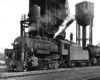 2-8-0 steam locomotive at coal and water facilities