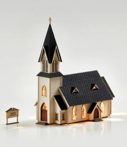 Model church with windows lit up