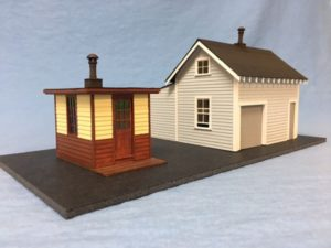 Laser wood kit of a shanty and house