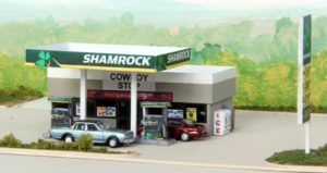 Model gas station with a car parked outside
