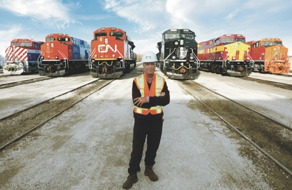 JJ Ruest standing in front of trains