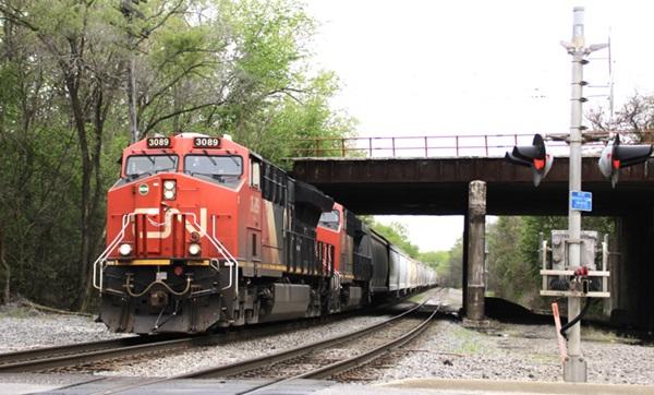 Train traveling under a bridge