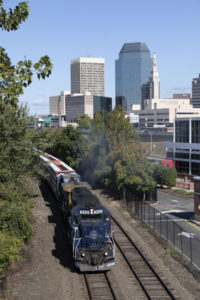A train passing by a city skyline