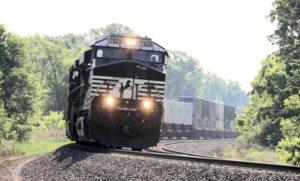 A Norfolk Southern train heads west through Otis, Ind