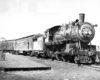 nn Arbor 4-4-2 steam locomotive with passenger train.