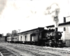 Ann Arbor 4-6-0 steam locomotive with passenger train .