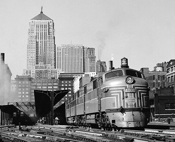 Streamlined diesel locomotives at passenger terminal.