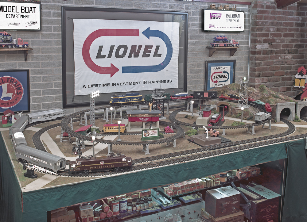 Highly detailed Lionel toy train layout with many collectible items.