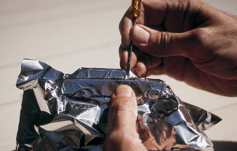 Model is wrapped with foil and details are burnished using a flat-bladed screwdriver.
