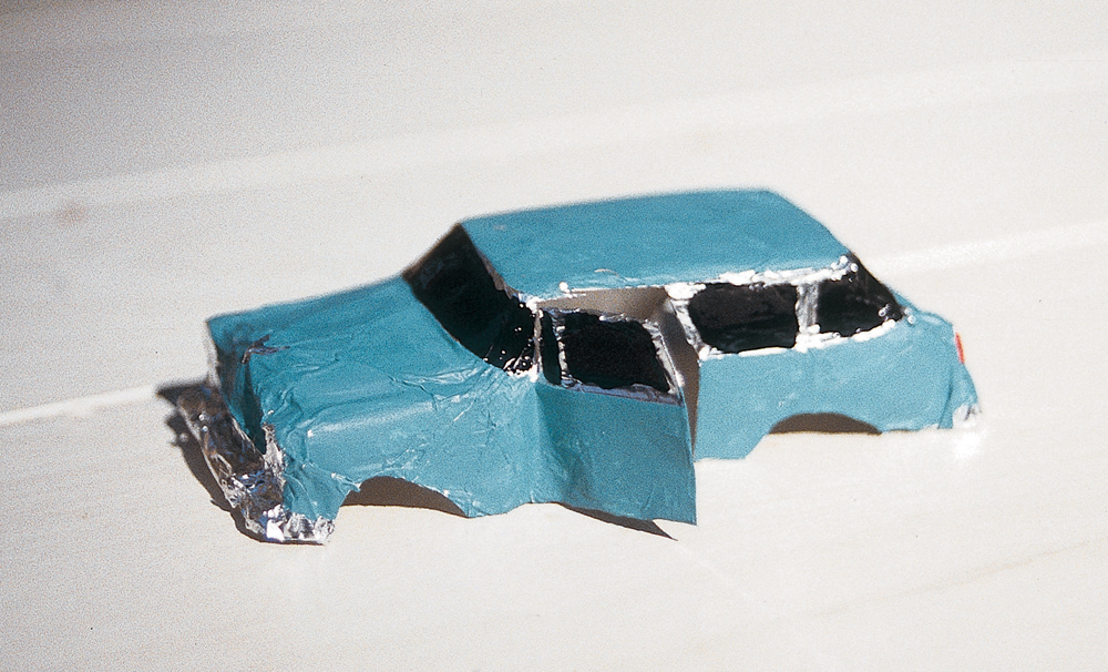 Painted foil model of a station wagon with black windows.