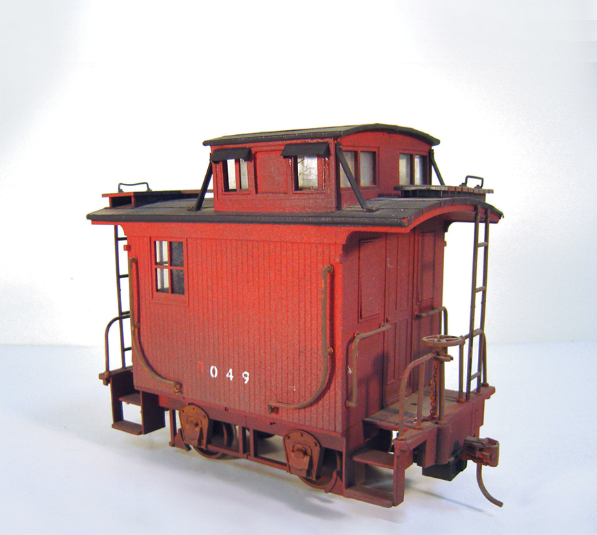 Weathering a large-scale caboose with spray paint.