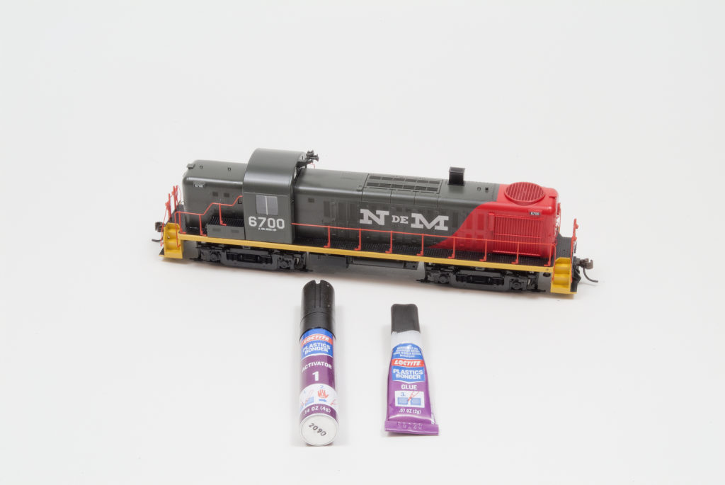 Athearn HO scale National Railways of Mexico Alco RS-3 diesel locomotive with Loctite plastics bonding system activator and glue