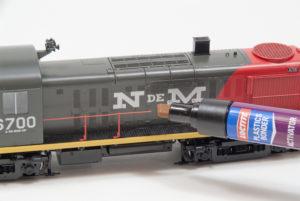 Applying Loctite plastics bonding system activator to broken handrail on HO scale Alco RS-3 diesel locomotive