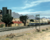 Santa Fe blue-and-yellow freight-painted cab units roll through Gary Hoover's depiction of southern California's arid mountains in this HO Scale model railroad