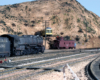 """A Santa Fe steam locomotive and caboose are posed at Gary Hoover's HO Scale representation of """"Summit"""", the top of the grade for the Santa Fe in California's Cajon Pass."""