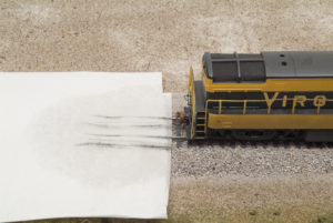Streaks of dirt from front and rear trucks on paper towel with front of H-16-44 visible at right of frame