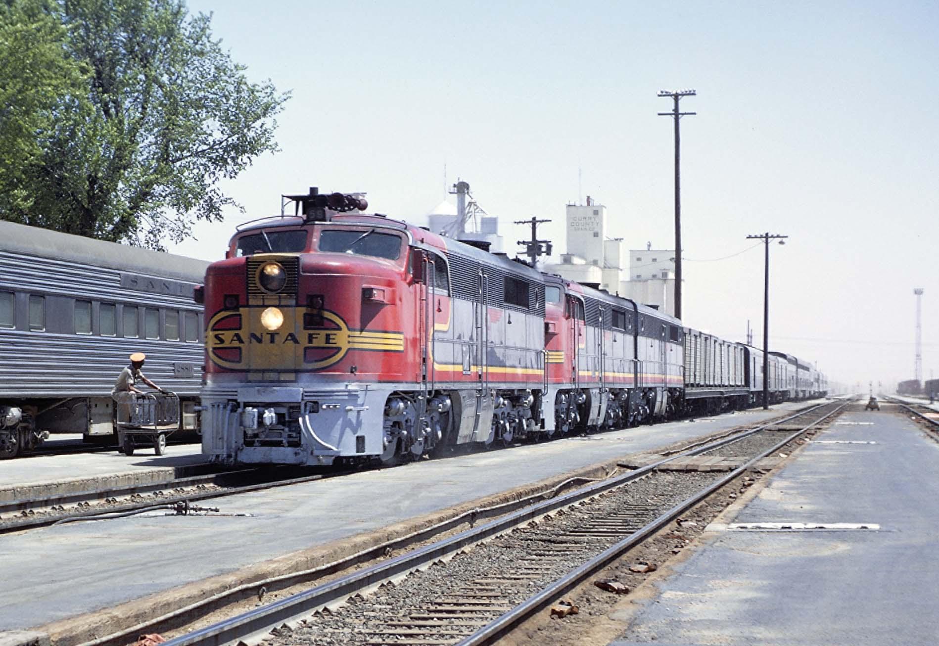 Diesel locomotives with Santa Fe San Francisco Chief passenger train at station