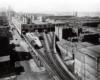 Elevated railroad tracks entering warehouse
