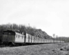 Caboose at end of train of special boxcars