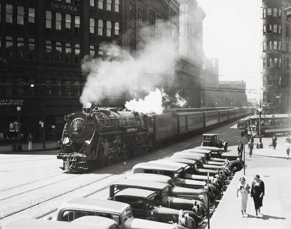 Hudson 5363 rolls down Washington Street in downtown Syracuse with an eastbound train. NYC passenger trains used this street trackage until a