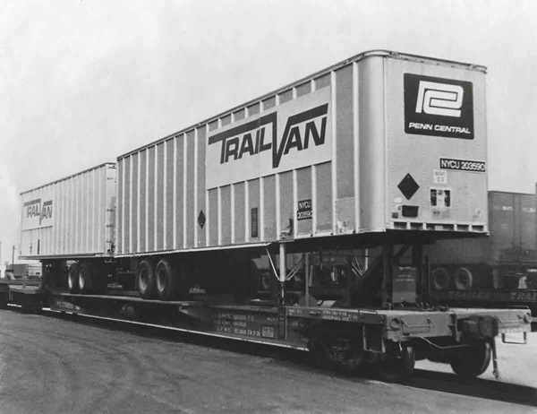 Modified for trailer-on-flatcar service as a test by Penn Central, a former Flexi-Van car carried trailers back-to-back.