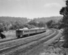 Budd RDCs on Philadelphia–Pottsville train 2007 (train 7 on weekdays), west of Valley Forge, Sunday, June 30, 1963.