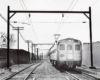 Budd Silverliner 9007 arrives at Fox Chase station on a run from Reading Terminal in 1966.
