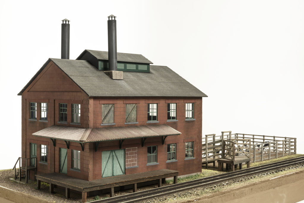 Brennan's Model Railroading O scale Richmond Packing Co. on scenicked diorama.]