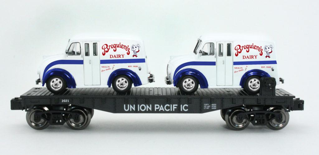 TCA Western Division Menards O gauge flatcar with Divco milk vans
